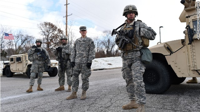 National Guard soldiers man a check point at the police command center set up at a shopping mall in Ferguson, Missouri, on November 27.