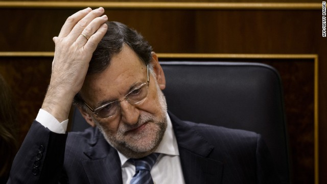Spanish Prime Minister Mariano Rajoy gestures during a control session at the Spain's Lower House of the parliament in Madrid on November 27, 2014. Rajoy will present today a new law aimed at tightening political party accounting rules, the day after his health minister resigned amid a massive corruption scandal. AFP PHOTO/ DANI POZODANI POZO/AFP/Getty Images