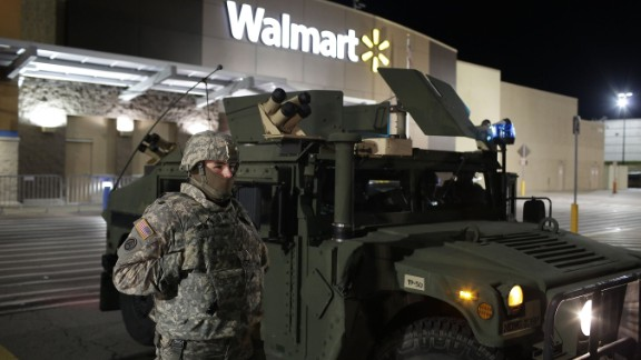 A National Guard troop stands outside of a closed Walmart on Thursday in Ferguson.