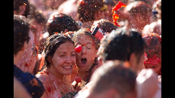 A tomato is about to hit two women as they take a selfie during a tomato fight in front of the Royal Palace in Amsterdam, Netherlands, on Sunday, September 14. The event was marketed as a protest of Russia