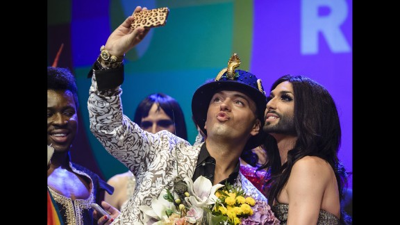 German actor Julian Stoeckel takes a selfie with Austrian singer Conchita Wurst, right, during a gala in Berlin on Friday, June 20. Wurst, the onstage drag persona of Thomas Neuwirth, won this year