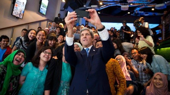U.S. Secretary of State John Kerry takes a selfie with a group of students in Jakarta, Indonesia, before delivering a speech on climate change on Sunday, February 16.
