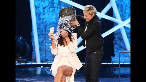 """Television host Ellen DeGeneres dumps a bucket of ice water on Kim Kardashian during an episode of """"Ellen"""" that aired Tuesday, September 9. It was part of the ALS Ice Bucket Challenge, a social media campaign that has been raising awareness and money to fight Lou Gehrig"""