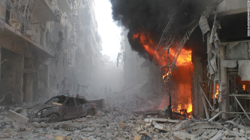 <strong>March 7:</strong> Debris covers a street in Aleppo, Syria, after a reported airstrike by Syrian government forces.