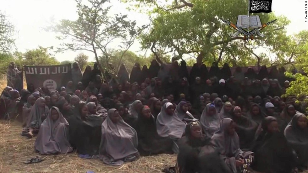 "<strong>May 12:</strong> This image, taken from video shot by Boko Haram militants, allegedly shows the Nigerian schoolgirls that the group abducted in April. More than 200 girls were taken, <a href=""http://www.cnn.com/2014/05/01/world/gallery/nigeria-girls-kidnapped/index.html"">sparking a global outcry.</a> The Islamist militant group, whose name means ""Western education is sin,"" <a href=""http://www.cnn.com/2014/12/01/world/africa/nigeria-boko-haram-attack/index.html"">later said it sold most of the girls into slavery.</a>"