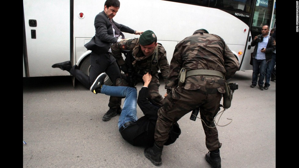 "<strong>May 14:</strong> Yusuf Yerkel, an aide to Turkish Prime Minister Recep Tayyip Erdogan, kicks a person who is being wrestled to the ground by two police officers during protests in Soma, Turkey. <a href=""http://www.cnn.com/2014/05/15/middleeast/gallery/turkey-mine-protests/index.html"">Hundreds of protesters took to the streets</a> across Turkey following <a href=""http://www.cnn.com/2014/05/13/europe/gallery/turkey-mine-accident/index.html"">a deadly mine fire that occurred near Soma</a> on May 13."