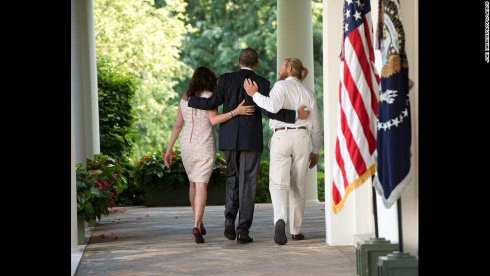 "<strong>May 31:</strong> U.S. President Barack Obama, center, walks with the parents of Army Sgt. Bowe Bergdahl after making a statement at the White House about <a href=""http://www.cnn.com/2014/05/31/world/asia/afghanistan-bergdahl-release/index.html"">Bergdahl's release.</a> Bergdahl had been held captive in Afghanistan for nearly five years, and the Taliban released him in exchange for five U.S.-held prisoners."