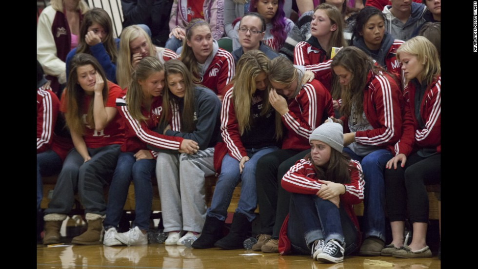 "<strong>October 26: </strong>Students grieve during a gathering at Marysville-Pilchuck High School in Marysville, Washington. Law enforcement officials say Jaylen Fryberg, a popular freshman at the school, <a href=""http://www.cnn.com/2014/10/24/us/gallery/washington-school-shooting/index.html"">shot five fellow students</a> before committing suicide on October 24."