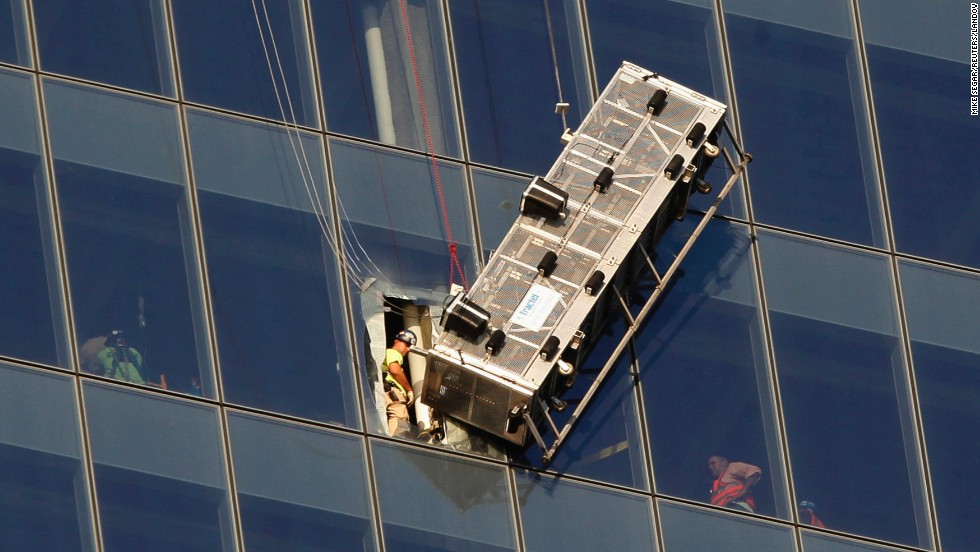 "<strong>November 12:</strong> New York emergency crews rescue <a href=""http://www.cnn.com/2014/11/12/us/gallery/wtc-scaffold/index.html"">two workers who were trapped on a window-washing scaffold</a> that was dangling at the 69th floor of the One World Trade Center building."