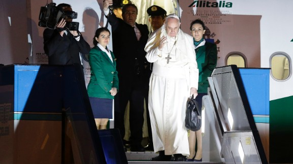 Pope Francis waves as he boards a plane for Rome at the Istanbul Ataturk airport on Sunday, November 30, concluding his three day visit the the predominantly Muslim country.