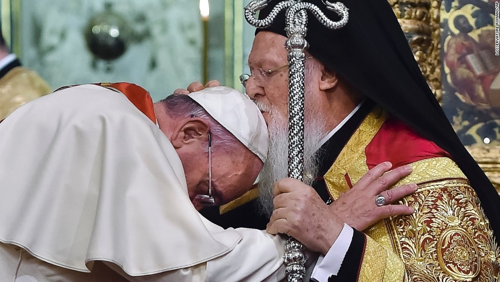 Ecumenical Patriarch Bartholomew I kisses the Pope during an ecumenical prayer at the Patriarchal Church of St. George in Istanbul on Saturday, November 29.