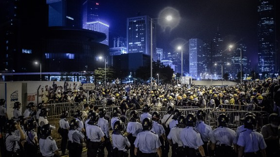 Pro-democracy protesters face police forces after clashes in the Admiralty district of Hong Kong on Sunday, November 30.