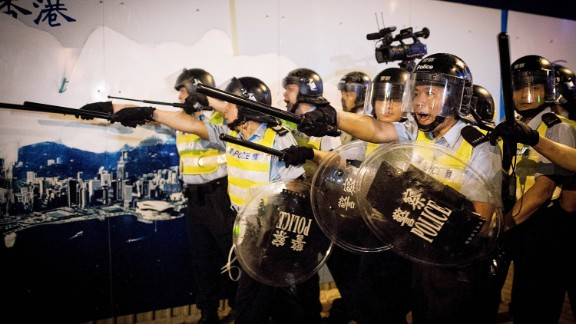 Police prepare to face protesters on Lung Wo Road outside Hong Kong