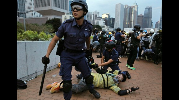 Police arrest a protester outside government headquarters in Hong Kong on December 1.