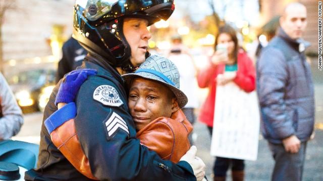 Devonte Hart, then 12, hugs Sgt. Bret Barnum at a rally in Portland, Oregon, in the year 2014.