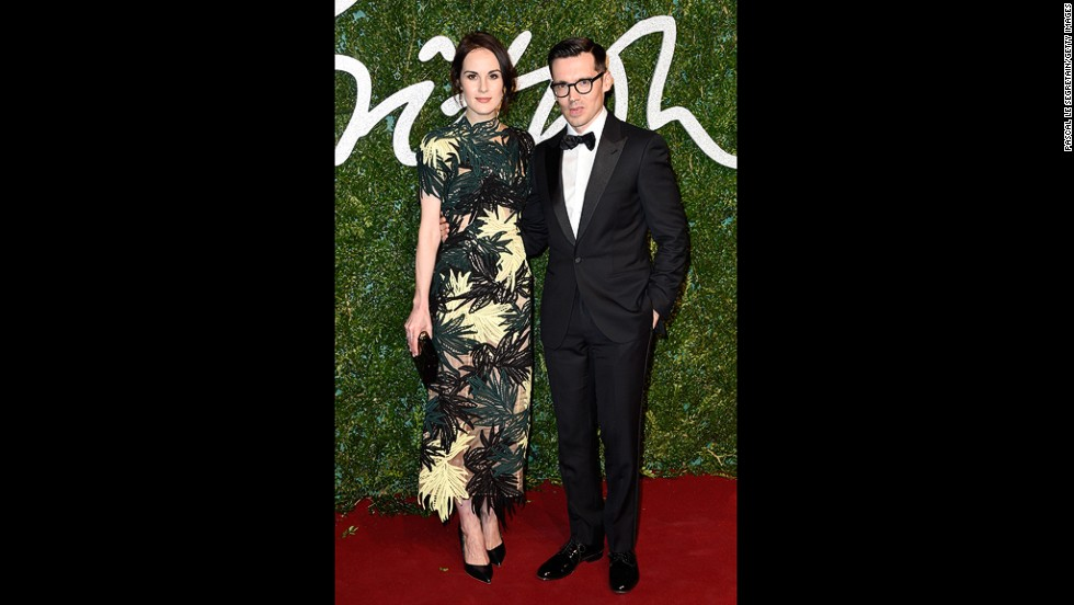 Erdem Moralioglu, here with actress Michelle Dockery, took home the award for the best womenswear designer. (Though Moralioglu is originally from Canada, his house was founded and remains based in London.)