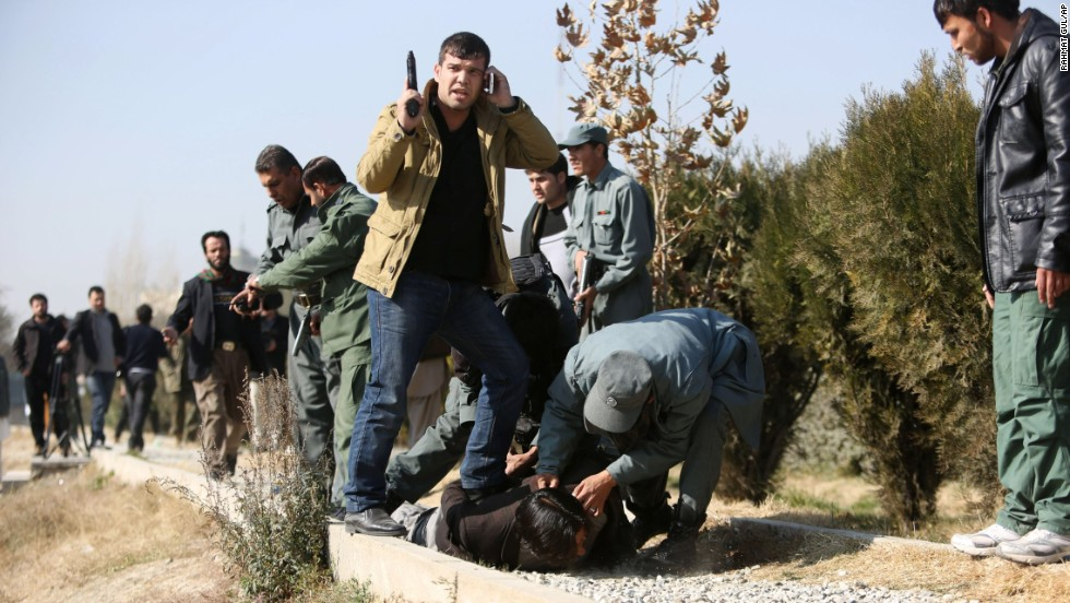 <strong>November 25:</strong> Afghan security personnel arrest a suspect after a bomb explosion in Kabul, Afghanistan.