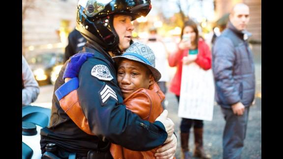 12-year-old Devonte Hart hugs Sgt. Bret Barnum.