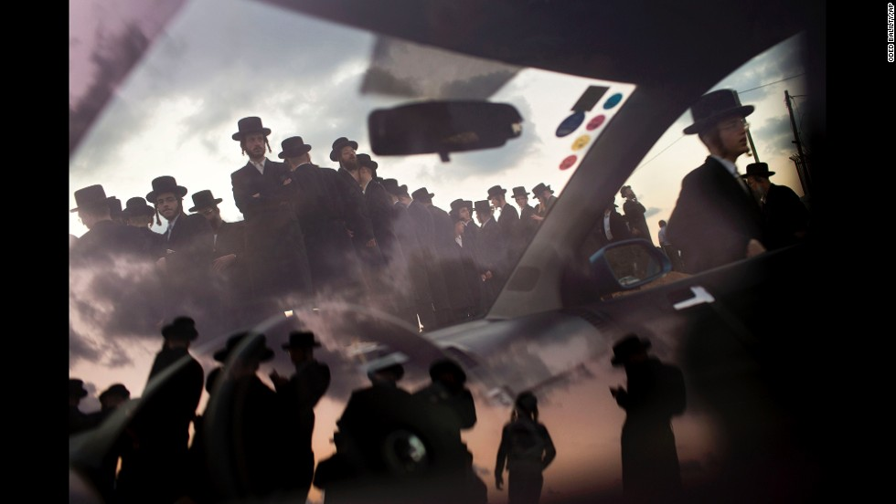 "<strong>October 2: </strong>Ultra-Orthodox Jews of the Hasidic sect Vizhnitz gather on a hill overlooking the Mediterranean Sea as they participate in a Tashlich ceremony in Herzliya, Israel. Tashlich, which means ""to cast away"" in Hebrew, is the practice by which Jews go to a large flowing body of water and symbolically ""throw away"" their sins by throwing a piece of bread, or similar food, into the water before <a href=""http://www.cnn.com/2013/09/13/world/gallery/yom-kippur/index.html"">the Jewish holiday of Yom Kippur.</a>"