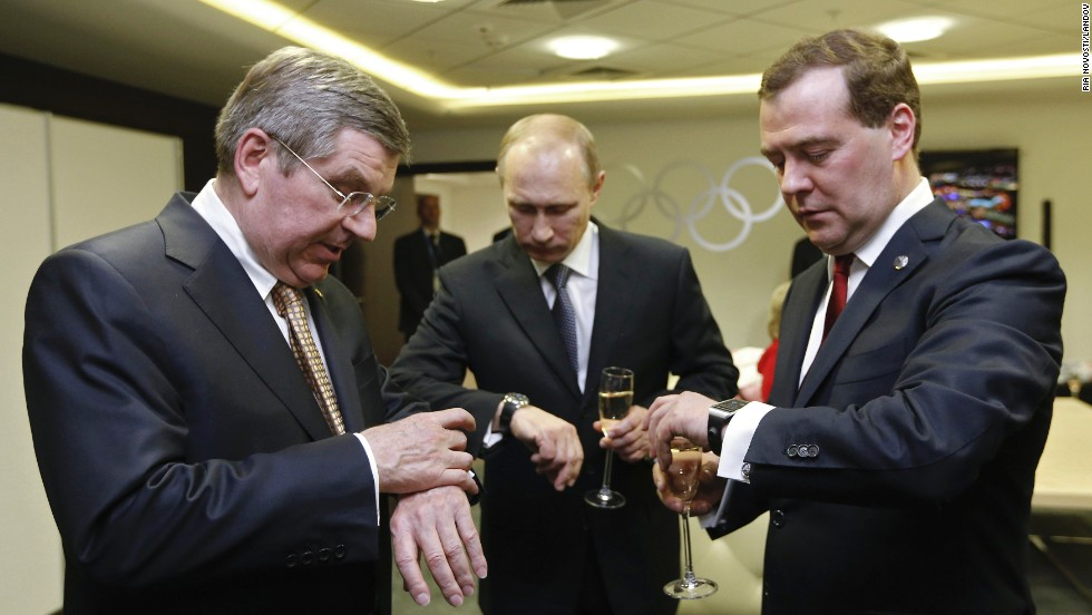 "<strong>February 23:</strong> From left, International Olympic Committee President Thomas Bach, Russian President Vladimir Putin and Russian Prime Minister Dmitry Medvedev look at their watches before the <a href=""http://www.cnn.com/2014/02/23/world/gallery/olympic-closing-ceremony/index.html"">closing ceremony of the Winter Olympics</a> in Sochi, Russia."