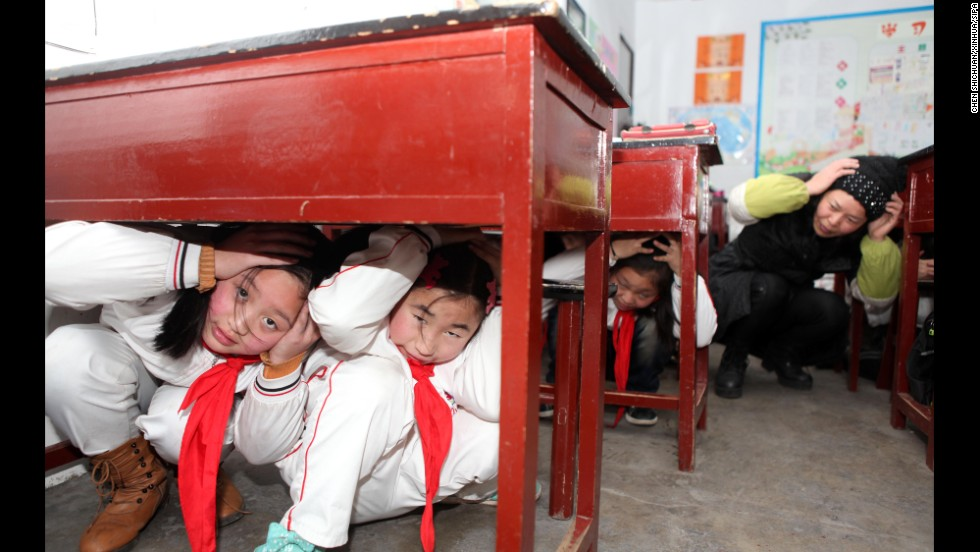 <strong>February 17:</strong> Children learn about disaster survival at the Hongzhuan Primary School in Chongqing, China.