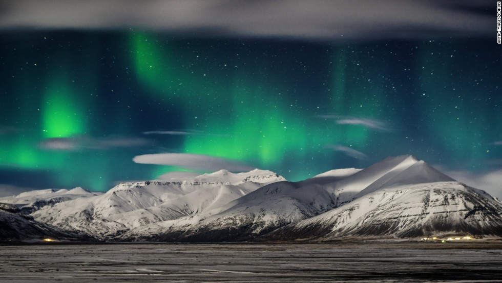 <strong>March 9:</strong> The Northern Lights appear over snow-covered mountains in Iceland.
