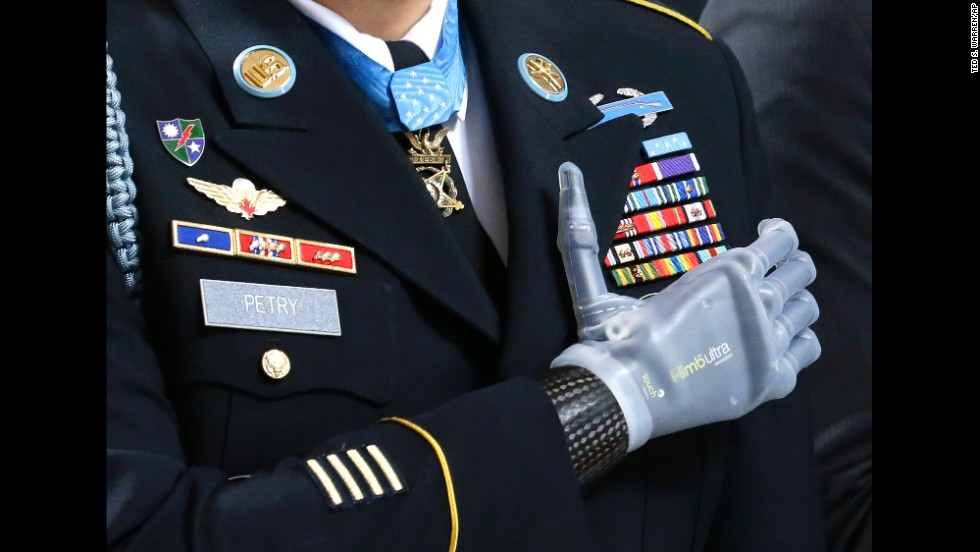 <strong>April 2:</strong> Sgt. 1st Class Leroy Petry stands during the Pledge of Allegiance at a ceremony held at the Capitol in Olympia, Washington. The ceremony honored Petry and other Medal of Honor recipients from Washington state. Petry lost his hand in 2008 when he was throwing an enemy grenade away from his fellow soldiers during combat in Afghanistan.