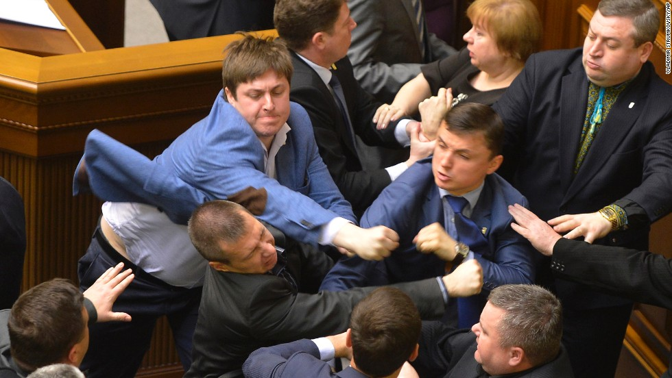 "<strong>April 8:</strong> Lawmakers scuffle during a parliament session in Kiev, Ukraine. The fight broke out when Petr Simonenko, the leader of the Communist Party, began to say lawmakers should listen to the demands of eastern Ukraine. He defended demonstrators who seized local government buildings, saying they are not doing anything different from what the interim government had done. He also accused ""nationalists"" of starting the crisis in eastern Ukraine."