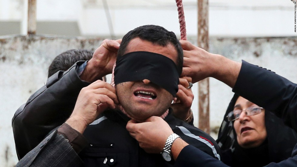 "<strong>April 15:</strong> The parents of Abdollah Hosseinzadeh remove a noose from the neck of his convicted killer, a man identified only as Balal, before Balal was to be hanged in Noor, Iran. Balal killed Hosseinzadeh during a street fight in 2007, according to the semi-official Iranian news agency ISNA. But just seconds before Balal was to be hanged, <a href=""http://www.cnn.com/2014/04/17/world/meast/iran-execution-photos-mother-forgives/index.html"">he was forgiven by Hosseinzadeh's mother.</a>"