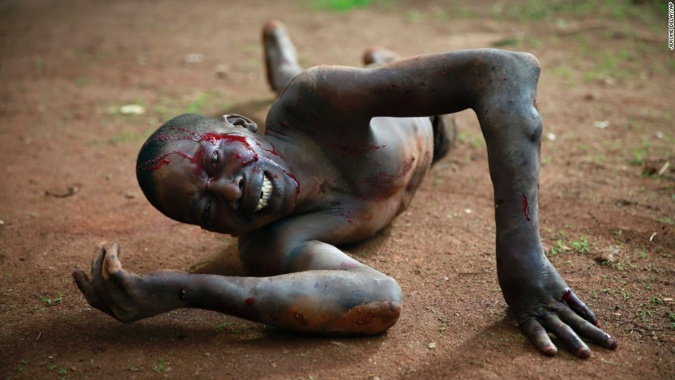"<strong>April 18:</strong> A man accused of being a thief lies in pain after being attacked by a man with a machete and sticks in Bangui, Central African Republic. Foreign journalists intervened and stopped the beating as the crowd shouted, ""He is a thief, he must die."" Police arrived and took the man into custody. He was then taken to a hospital for treatment before being brought before a prosecuting officer."
