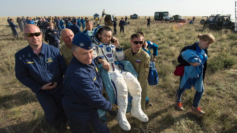 <strong>May 14:</strong> Astronaut Koichi Wakata is carried to a medical tent just minutes after he and two others landed in Kazahkstan on their return to Earth. Wakata, Mikhail Tyurin and Rick Mastracchio spent more than six months aboard the International Space Station.