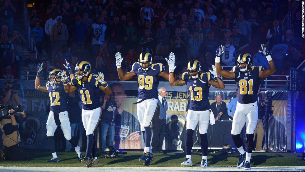 "<strong>November 30:</strong> From left, St. Louis Rams Stedman Bailey, Tavon Austin, Jared Cook, Chris Givens and Kenny Britt put their hands up before playing the Oakland Raiders in St. Louis. <a href=""http://www.cnn.com/2014/12/01/us/ferguson-nfl-st-louis-rams/index.html"">The gesture</a> was meant to show support for Michael Brown, the teenager who was killed in the St. Louis suburb of Ferguson."