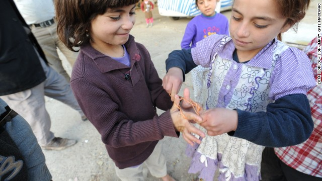 Oulah, 5, and Zareh, 7, play cat's cradle with a piece of found twine. The children rely on their imaginations alone for play. While children claim their greatest needs are toys, parents say the priority now must be in preparing for the harsh change in seasons.