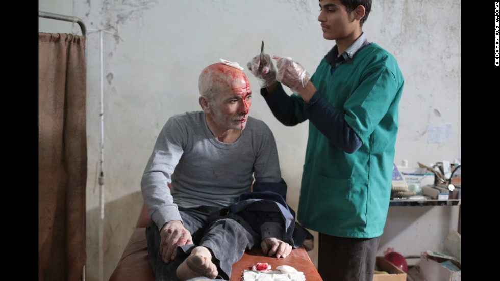 A wounded man is treated at a makeshift hospital in Damascus, Syria, following a reported air strike by government forces on Tuesday, November 11.