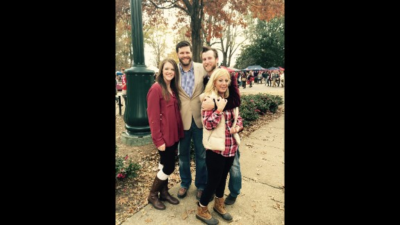 Vests are a go-to in the fall for guys and girls alike, says Jessie McKissick, far right. She ordered a cream vest from a Mississippi boutique to complete her outfit for the Egg Bowl, the annual game between state rivals Mississippi State University and the University of Mississippi.