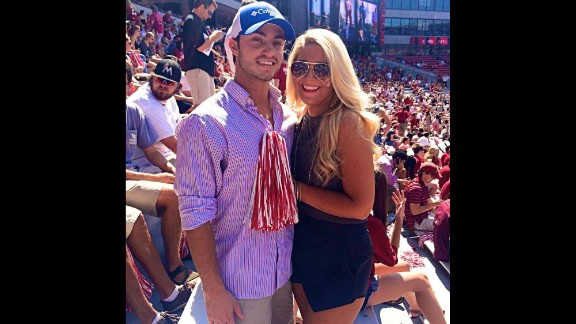 For guys, button-down shirts and khakis are game-day staples. University of Alabama sophomore Gabrielle Atchison, right, poses with a friend at the Bryant Denny Stadium in Tuscaloosa.