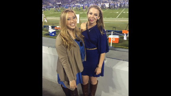 """University of Kentucky senior Bethany Ball, right, poses with a friend at the school's homecoming game. A huge game day style no-no for Ball is wearing two different prints. """"It can be overwhelming and clash,"""" she said."""