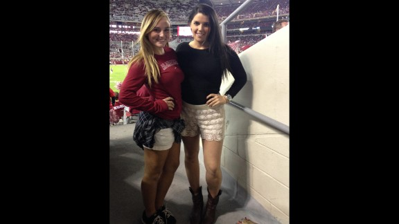 """Game day fashion """"is all about feeling comfortable in what you are in and being able to pull pieces together to create a look,"""" said Melissa Alpuche, right, shown here cheering on the University of Alabama. More game day style no-no's include """"showing too much skin, over-the-top makeup,"""" and, of course, wearing the opponents' colors, she said."""