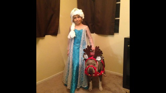 Abcde Santos, 7, has autism and is assisted by her service dog, Pup-Cake.