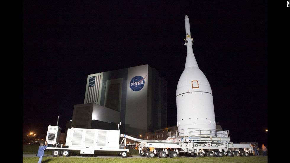 Orion is wheeled past the iconic Vehicle Assembly Building at NASA's Kennedy Space Center on November 11, 2014, on its way to Launch Complex 37 at Cape Canaveral Air Force Station.