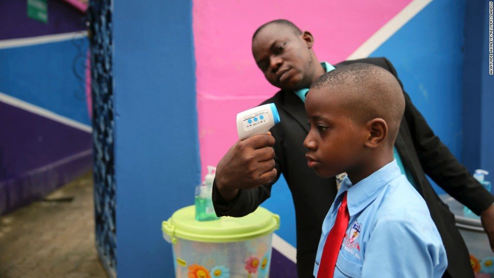 "<strong>September 22:</strong> Amid the Ebola scare in West Africa, a school official in Lagos, Nigeria, takes a student's temperature with an infrared laser thermometer. Health officials say <a href=""http://www.cnn.com/2014/04/04/world/gallery/ebola-in-west-africa/index.html"">the Ebola outbreak in West Africa</a> is the deadliest ever. More than 5,600 people have died there, according to the World Health Organization."