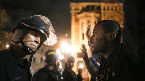 Protesters face off with police in Oakland.