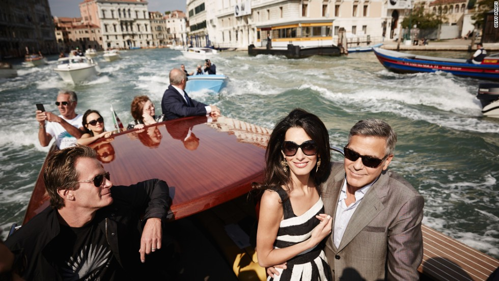 "<strong>September 26:</strong> Actor George Clooney, right, and his fiancee, lawyer Amal Alamuddin, arrive in Venice, Italy, on Friday, September 26. The two were married that weekend in a private ceremony <a href=""http://www.cnn.com/2014/09/27/showbiz/gallery/clooney-wedding/index.html"">attended by some of their celebrity friends.</a> At left is Rande Gerber, husband of model Cindy Crawford."