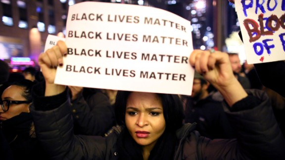 People protest in New York against the decision not to indict a white police officer in the chokehold death of Eric Garner.