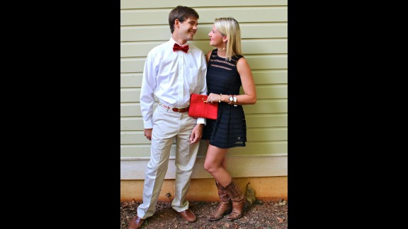 """Chandler MacWilliam, right, a senior at the University of Alabama and a fashion blogger, models a game-day look with her boyfriend. She says she spends $50 to $200 on a typical tailgate outfit, which must always feature something red, black, white or gray. """"I refuse to dress in any color but those four."""""""