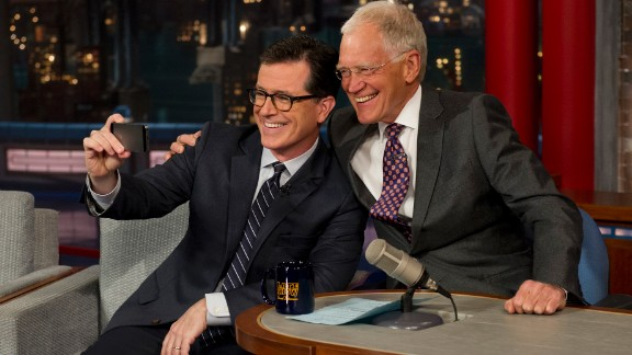 """Funnyman Stephen Colbert, left, takes a selfie with David Letterman on the """"Late Show with David Letterman"""" on Tuesday, April 22. It was Colbert's first visit to the show since CBS announced <a href=""""http://www.cnn.com/2014/04/10/showbiz/gallery/stephen-colbert/index.html"""">Colbert would succeed Letterman</a> when Letterman retires in 2015."""