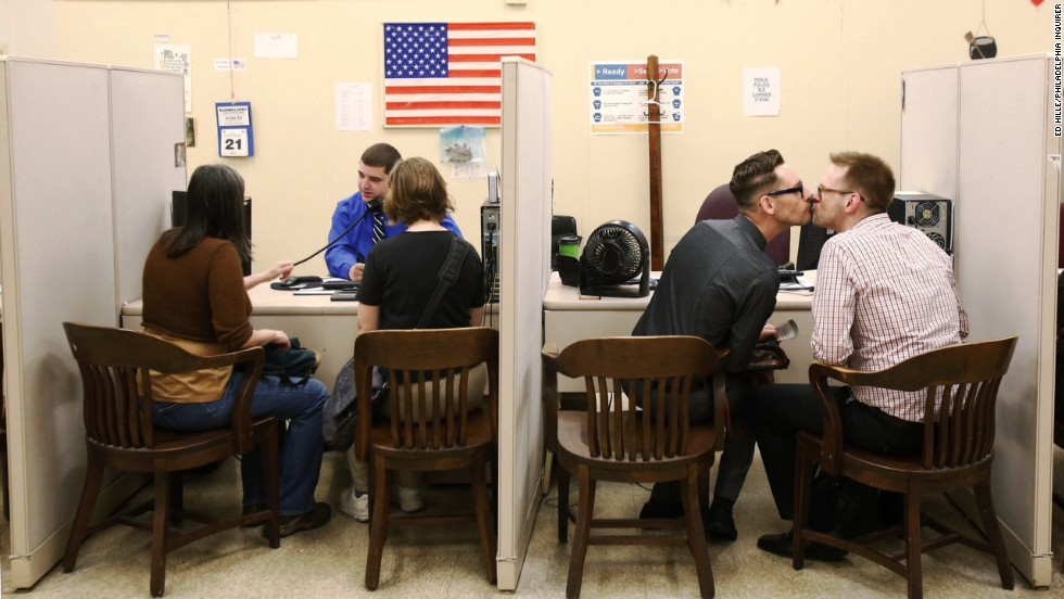 <strong>May 21:</strong> Two same-sex couples -- Eliza Callard and Emily Gavin, left, and Christopher Whibley and Bill Good, right -- complete their paperwork for marriage licenses at Philadelphia City Hall. A day earlier, a federal judge struck down Pennsylvania's ban on same-sex marriage, declaring it unconstitutional.