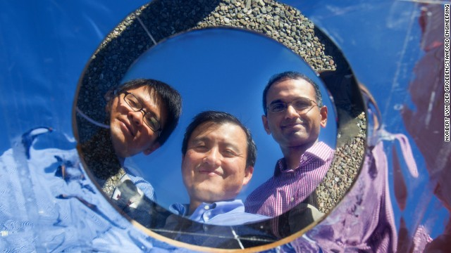 Shanhui Fan (center) and grad students Linxiano Zhu and Aaswatch Raman show off their invention.