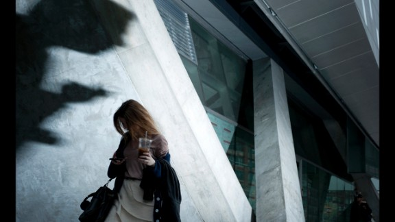 A woman checks her phone in New York. Losekoot has also visited Hong Kong; Seoul, South Korea; Mumbai, India; and London.
