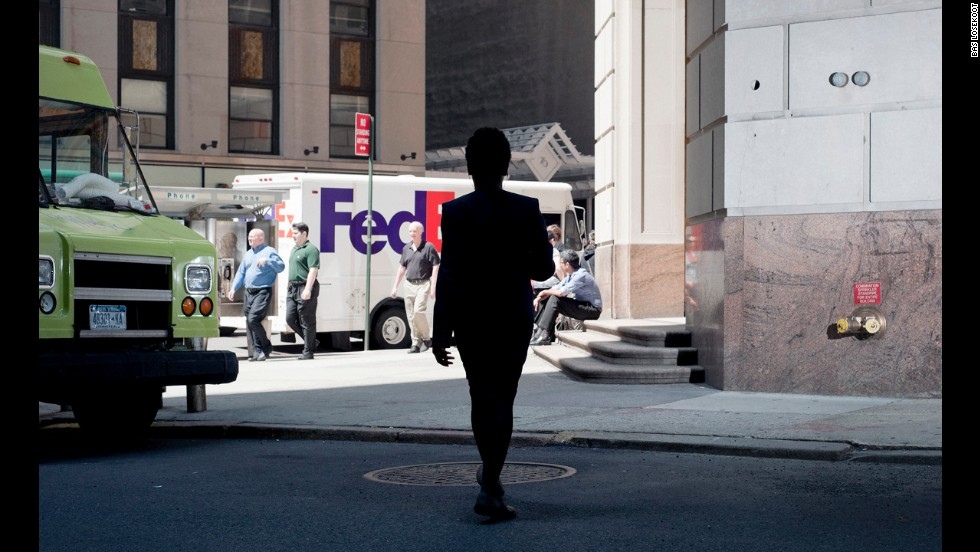 A person appears as a silhouette in New York.